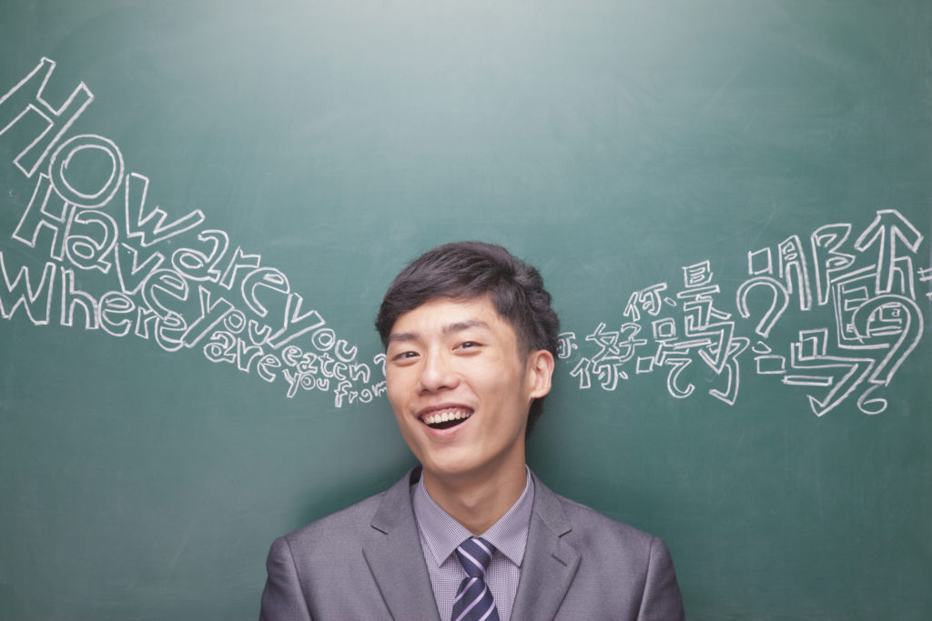 Young businessman with Chinese and English script